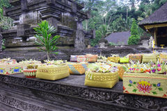 Boxes  in the Tirta Empul Temple in Bali, Indonesia. Boxes containing the offerings to the gods at the full moon ritual in the Tirta Empul Temple in Bali Royalty Free Stock Photography