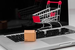Boxes in and trolley on a laptop online shopping is a form of electronic commerce that allows consumers to directly buy royalty free stock photos