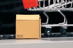 Boxes in and trolley on a laptop online shopping is a form of electronic commerce that allows consumers to directly buy stock photos