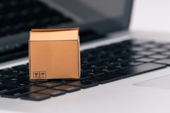 Boxes in and trolley on a laptop online shopping is a form of electronic commerce that allows consumers to directly buy stock photography