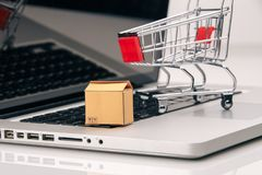 Boxes in and trolley on a laptop online shopping is a form of electronic commerce that allows consumers to directly buy stock image