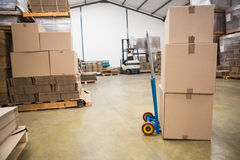 Boxes on trolley in warehouse Stock Photos