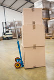 Boxes on trolley in warehouse Stock Photo