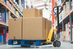 Boxes on trolley in warehouse. Cardboard boxes on trolley in warehouse Royalty Free Stock Images