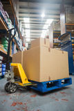 Boxes on trolley in warehouse Stock Image