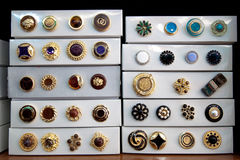 Boxes of vintage buttons. For sale in a haberdashery shop Royalty Free Stock Photography