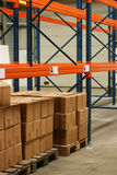 Boxes in a Warehouse. They are stored on some warehouse shelves stock images