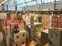 Boxes with wine bottles stacked inside a wholesale supermarket. Copenhagen, Denmark - April 19, 2019 stock photo