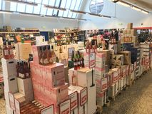 Boxes with wine bottles stacked inside a wholesale supermarket. Copenhagen, Denmark - April 19, 2019 stock photography