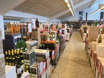 Boxes with wine bottles stacked inside a wholesale supermarket in top view. Copenhagen, Denmark - April 19, 2019 royalty free stock photo