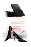 Boxes and woman shoes Royalty Free Stock Photo