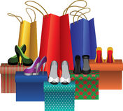 Boxes with woman shoes and shopping bags Stock Photo