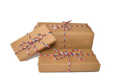 Boxes wrapped in brown eco paper. Isolated on white background royalty free stock images