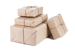 Boxes wrapped with brown kraft paper isolated on white backgroun Royalty Free Stock Image