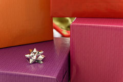 Boxes wrapped in colorful paper Stock Images
