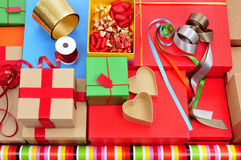 Boxes, wrapping paper and ribbons Royalty Free Stock Photo