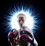 Boxeur professionnel d'isolement dans l'obscurit? noire de fond image libre de droits