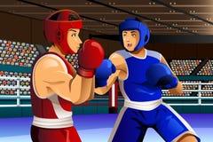 Boxeurs combattant en anneau Photos stock