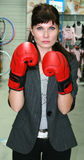 Boxing. Business woman with red boxing gloves on Royalty Free Stock Photo