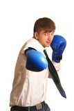 Boxing. A young man in a shirt and a tie boxing Stock Photography