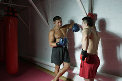 Boxing. Two boxers talk among themselves against a wall Stock Photo