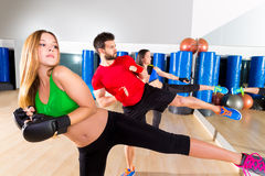 Boxing aerobox group low kick training at gym. Boxing aerobox group low kick training at fitness gym mirror Royalty Free Stock Photo