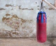 Boxing bag on grunge background Stock Image