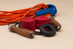 Boxing bandages, expander, multiple fiber and leather jump rope Royalty Free Stock Photography
