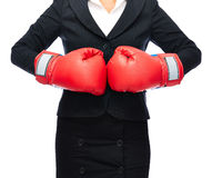 Boxing business gloves. Faceless business woman punching gloves together.   Isolated on a white background Stock Images