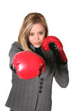 Boxing Business Woman. A business woman with boxing gloves punching Stock Photo