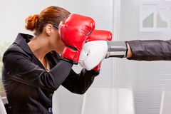 Boxing business woman defending from a punch Stock Images