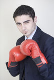 Boxing businessman. With red gloves on his head stock photos