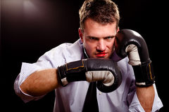 Boxing businessman throwing left hook Stock Images