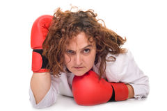 Boxing businesswoman on floor Royalty Free Stock Images