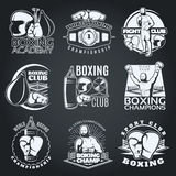 Boxing Clubs And Competitions Monochrome Emblems. With sportsman gloves punching bags on black background isolated vector illustration Royalty Free Stock Photos
