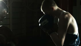 The boxing coach trains the young boxer. Workout of boxing hitting of young boxer stock video footage