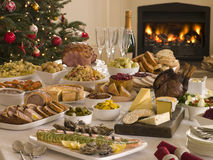 Boxing Day Buffet Lunch Christmas Tree. And Log Fire Stock Image