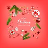 Boxing day card. Flat lay Christmas composition with fir tree branches on red holiday background. Top view of Natural design elements. Festive background with Royalty Free Stock Photo