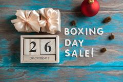 Boxing day sale. And gift boxes with bows on blue shabby wooden background Royalty Free Stock Photography