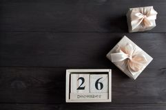 Boxing day sale. And gift boxes on brown wooden background Stock Photography