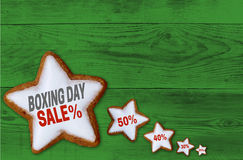 Boxing Day Sale cinnamon star on green wood concept Royalty Free Stock Photography