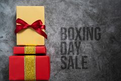 Boxing day Sale concept Christmas gift box on cement background, top view stock images