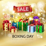 Boxing Day Sale gift boxes gold bokeh lights wallpaper. Boxing Day Sale poster. Gift Boxes for Christmas and New Year Winter Holiday, celebrate, beautiful gift Stock Photos