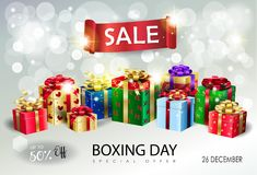 Boxing Day Sale gift boxes on bokeh lights wallpaper. Boxing Day Sale poster. Gift Boxes for Christmas and New Year Winter Holiday, celebrate, beautiful gift Stock Photography