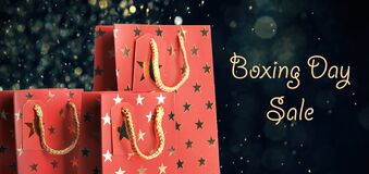 Free Boxing Day Sale. Shopping Bags And Lights On Dark Background, Banner Design Royalty Free Stock Image - 179555746