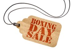 Boxing day sale sign on isolated price tag. Boxing day sale sign  - a paper price tag with twine isolated on white- shopping concept Stock Image