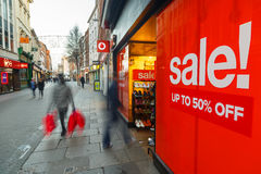 Boxing Day sales poster and sales shoppers on Clumber Street in Royalty Free Stock Photography
