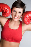 Boxing Fitness Woman. Beautiful angry boxing fitness woman Stock Image