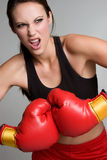 Boxing Fitness Woman. Beautiful angry fitness woman boxing Royalty Free Stock Photo