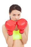 Boxing fitness woman concentrating and protecting pose. In studio stock photos
